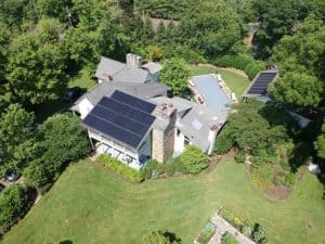 Aerial drone view of home with solar panels installed.