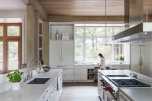 Open air kitchen with expansive natural light from large oversized windows