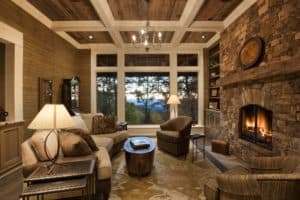 Coffered ceilings and expansive windows that open to beautiful views of the mountains, make this living room even better.