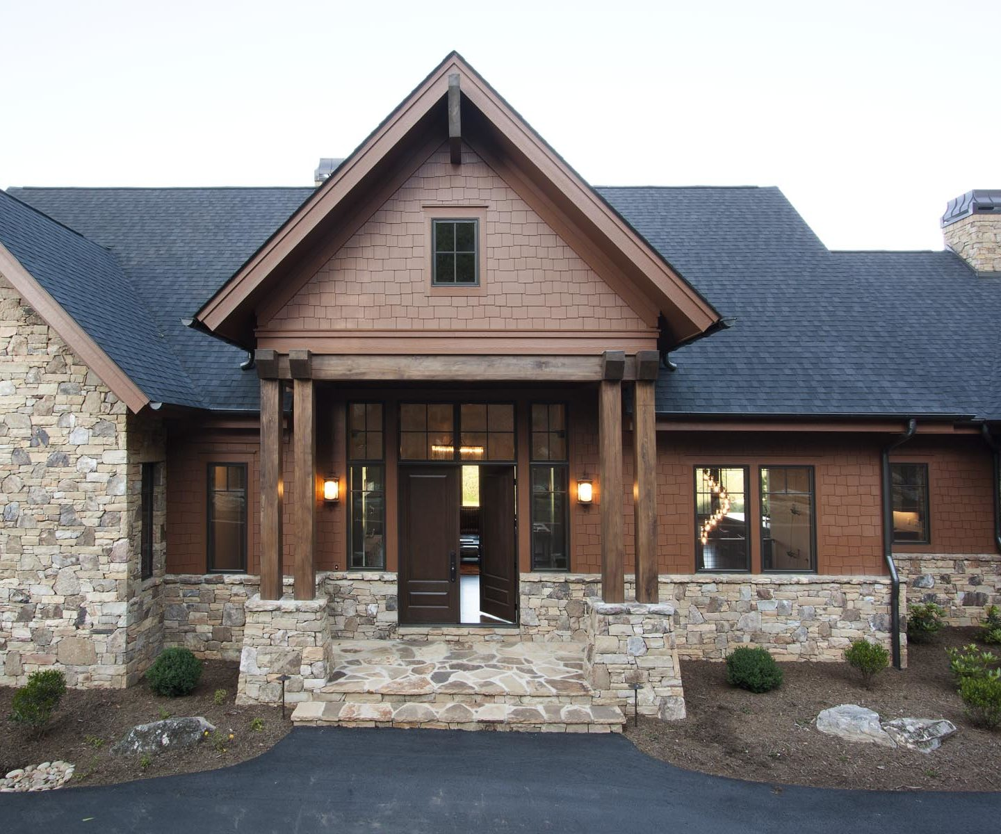 Ridgepine features a wood and stone exterior for this luxury home build.