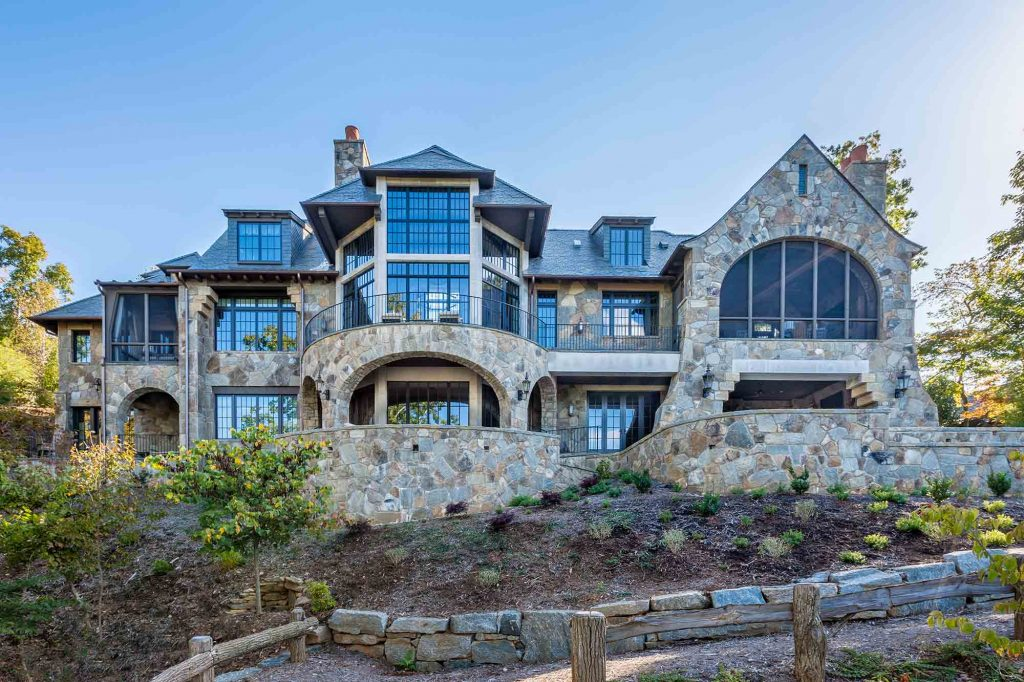 Large, stately stone home with expansive windows