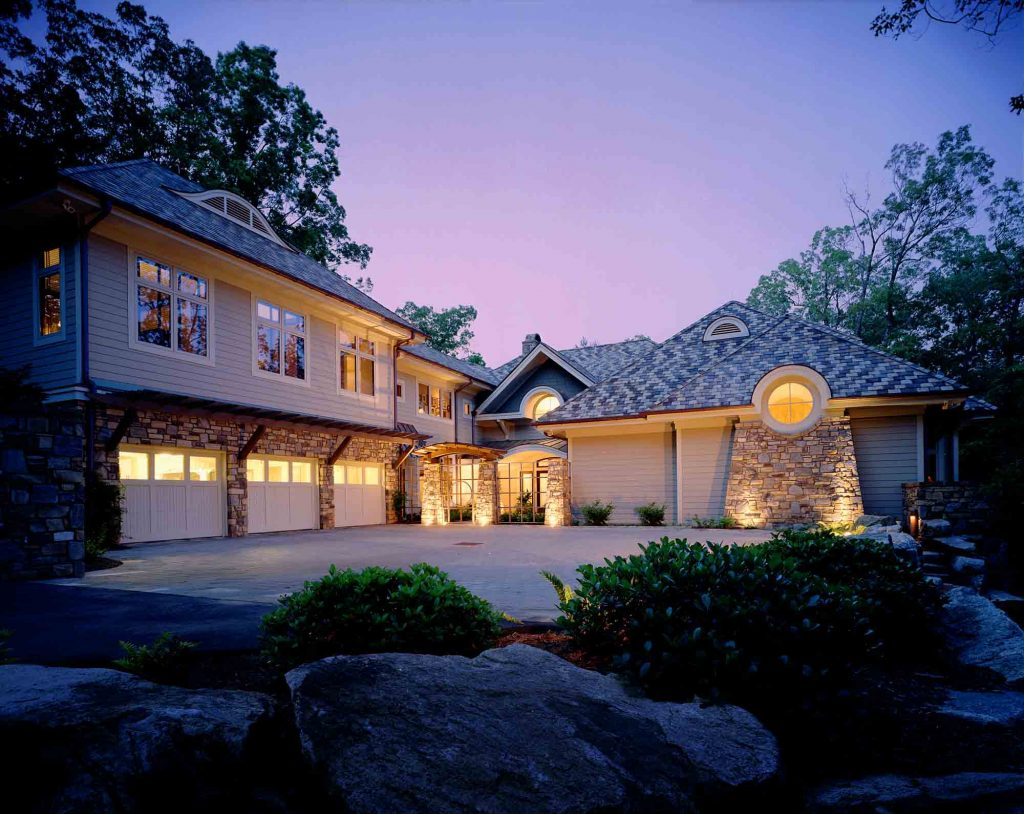Beautiful home with accent lighting at dusk