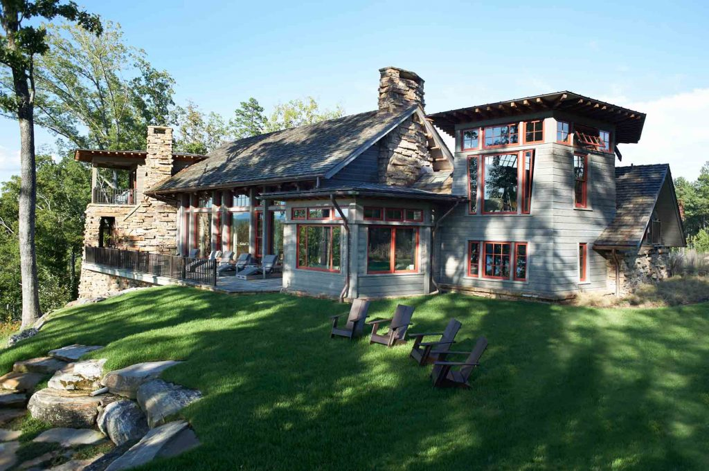 Beautify grey home with red trim and stone chimneys
